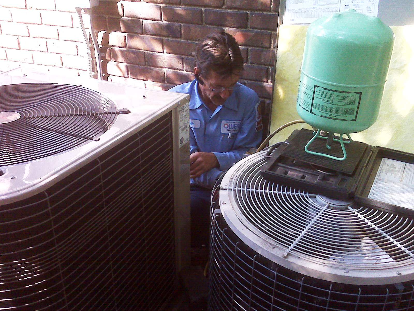 An Owens technician working on air conditioners