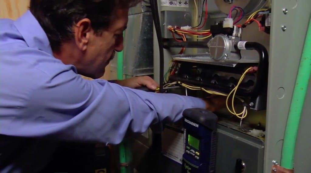 A man working on a furnace